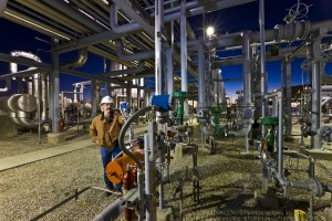 A technician checks gauges at a Whiting Petroleum natural gas processing plant. Photo courtesy of Whiting Petroleum.